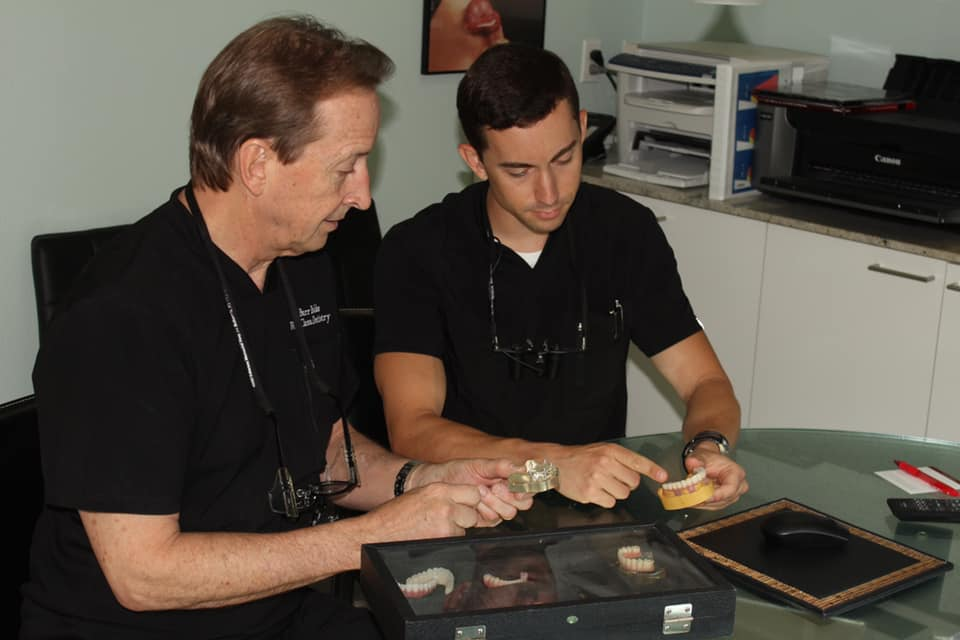 Dr. Burr Bakke and his son Cameron working together at World Class Dentistry,